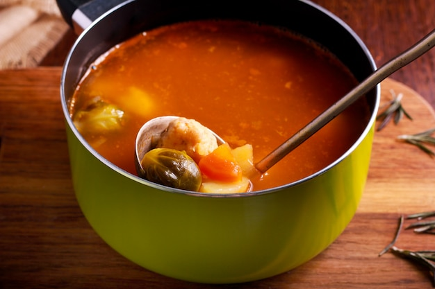 Soup with brussels sprouts, chicken and red lentil