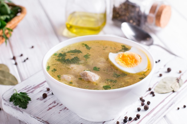 Soup with chicken meatballs and vegetables and egg