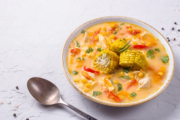 Soup with corn garnished with slices of ripe corn pumpkin