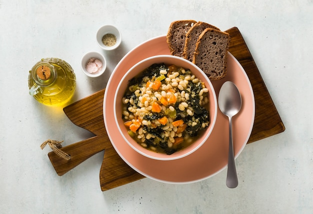 Soup with kale and beans in a bowl