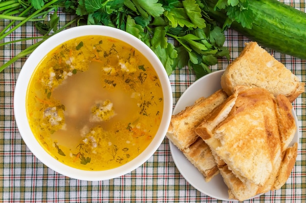 Soup with meatballs and toast with cheese