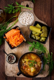 Soup with pickled cucumbers and beans in ukrainian style. top view
