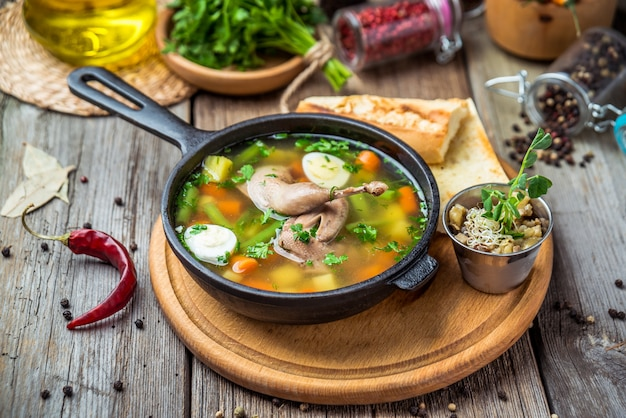 Soup with quail meat, with quail eggs and vegetables