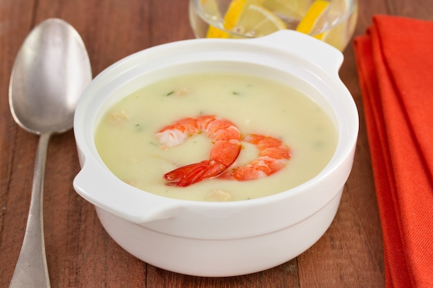 Soup with shrimps in the white bowl