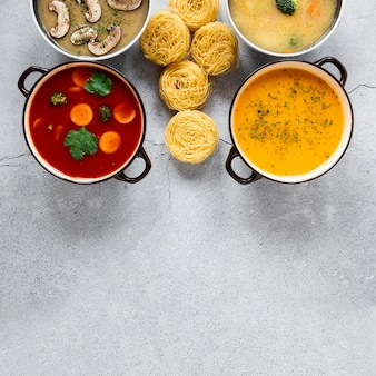 Soups and pasta rolls flat lay