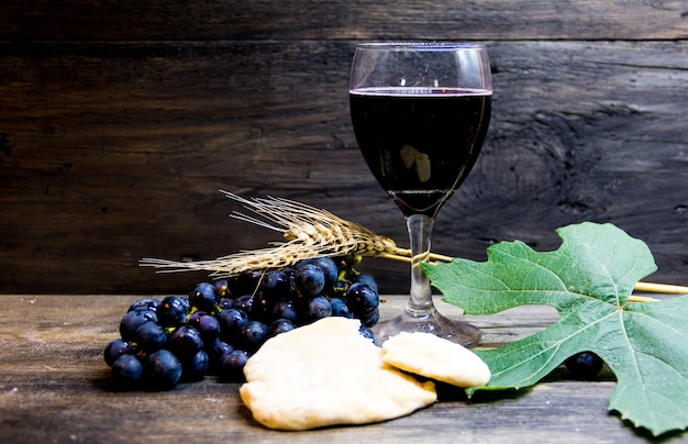 Sour bread, wine, grapes and wheat symbol of christian communion