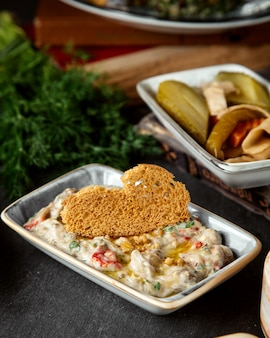 Sour cream salad with cracker and pickles
