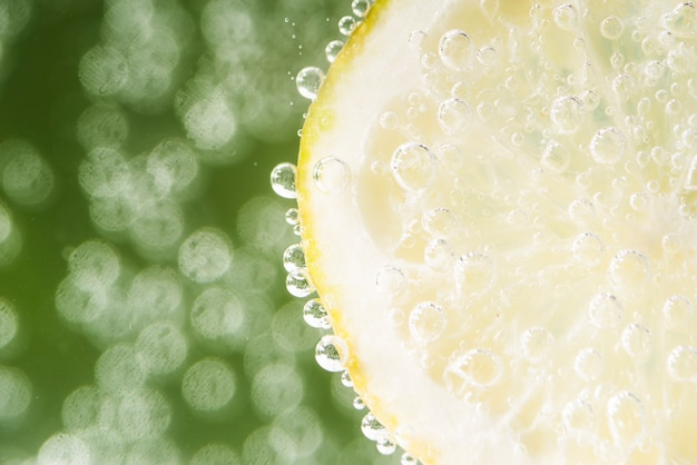 Sour lemon slice with defocused background