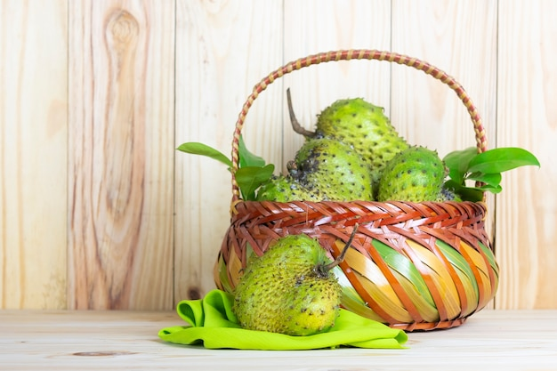Soursop fruit on wooden table