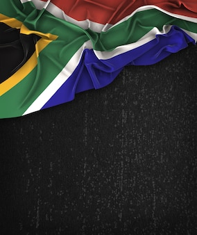 South africa flag vintage on a grunge black chalkboard with space for text