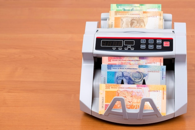 South african money in a counting machine