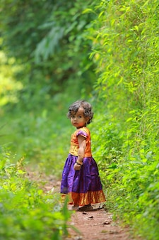 South indian cute girl kid wearing  beautiful traditional dress long skirt and blouse