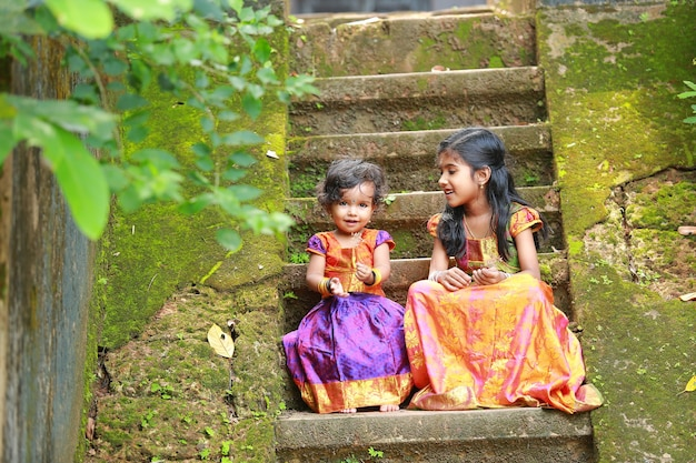 South indian girl kids wearing  beautiful traditional dress long skirt and blouse