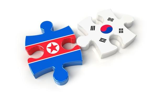 韓国と北朝鮮はパズルのピースにフラグを立てます。政治的関係の概念。 3dレンダリング