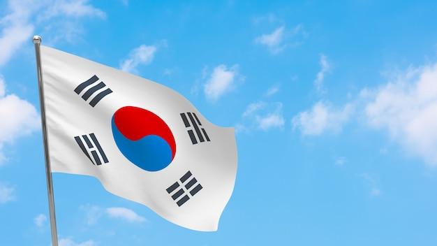 극에 한국 플래그입니다. 파란 하늘. 대한민국 국기