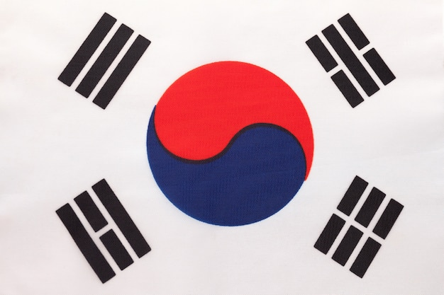 South korea national fabric flag, textile background. symbol of international asian world country.