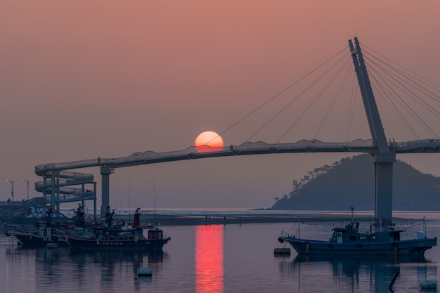 South korea, taean-gun's anmyundo port, sun on bridge.