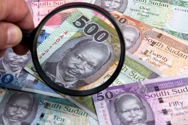 South sudan money in a magnifying glass a business background