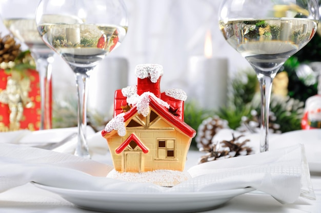Souvenir in the form of a christmas house on the christmas table