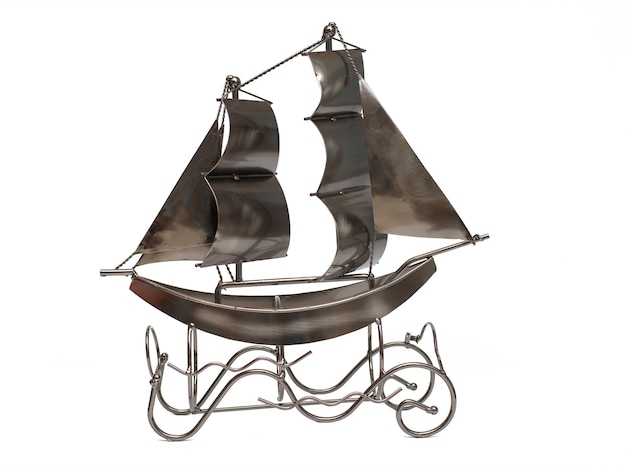 Souvenir toy boat on white isolate for gift with sails