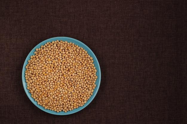 コピースペース、健康的なコンセプトとテーブルの背景に大豆。