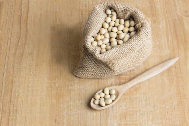 Soy bean on wooden of brown table