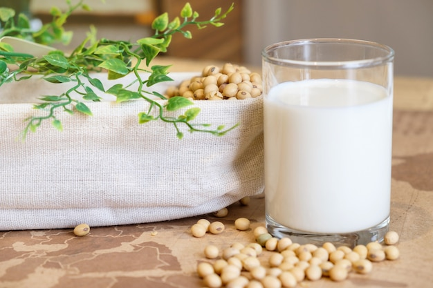 Soy milk in glass and soy bean on bucket. nature healthy concept.