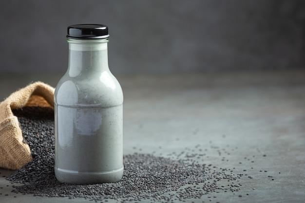 Soy milk mix black sesame on dark background Free Photo