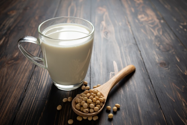 Soy milk and soy bean on wooden table.