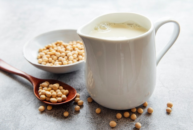 Soy milk and soy on the table - healthy plant product Premium Photo