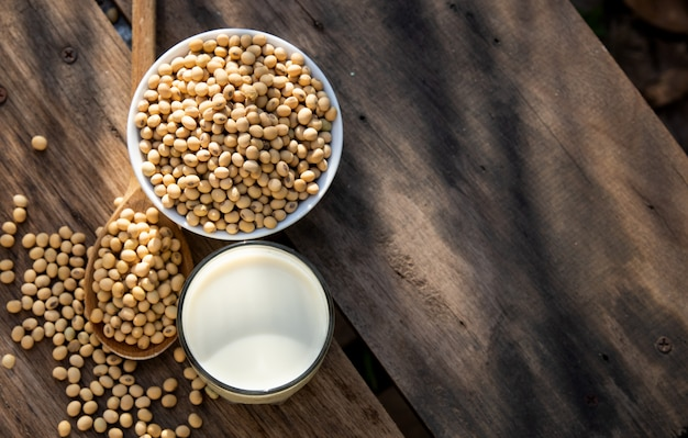 Soy milk and soybeans on wooden table  with lighting in the morning