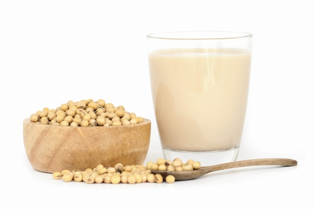 Soy milk with soybeans isolated