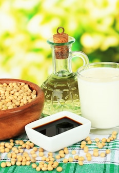 Soy products on table on defocused nature