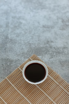 Soy sauce on a bamboo napkin