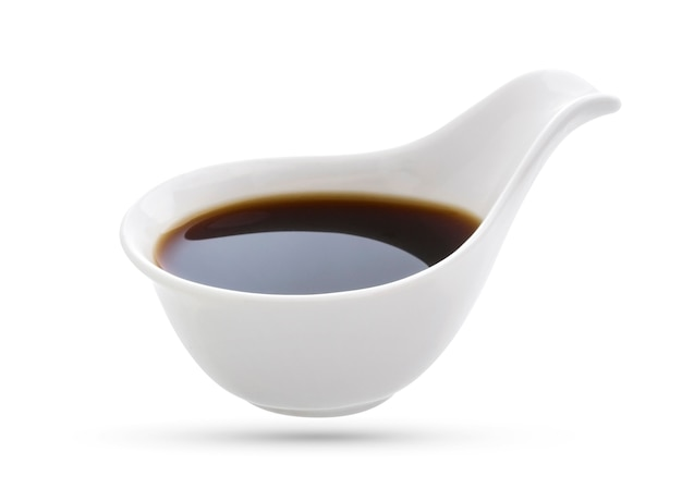 Soy sauce in bowl isolated on white.