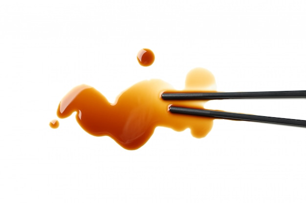 Soy sauce spot isolated on white background, top view