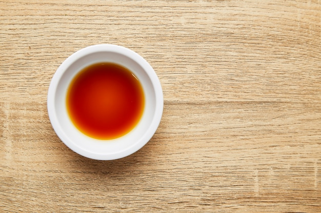 Soy sauce on wooden