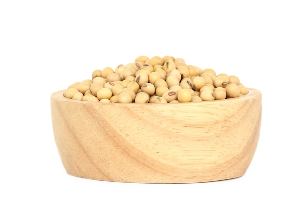 Soybean in wooden bowl isolated on white background.