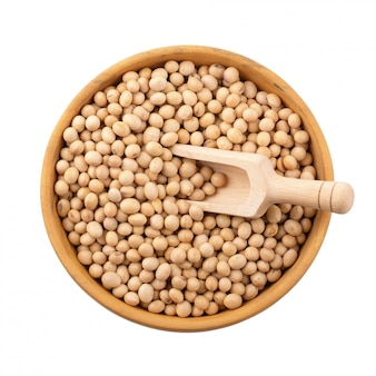 Soybean in a wooden bowl isolated on white background
