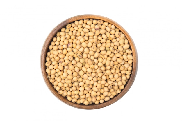Soybeans in a wooden bowl isolated on white background.
