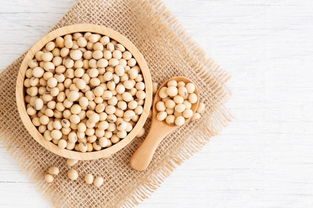 Soybeans in wooden bowl with wooden spoon on table wooden