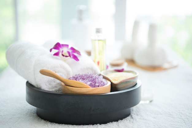 Spa accessories aromatic candle, orchid flower, salt scrub and towel.