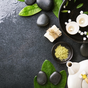 Spa accessories on dark wet background