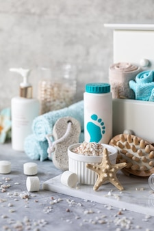 Spa accessories - sea salt, powder, tablets for a bath, pumice, cream on a light background. healthy lifestyle concept. cosmetics for skin care feet. decor for the bathroom.
