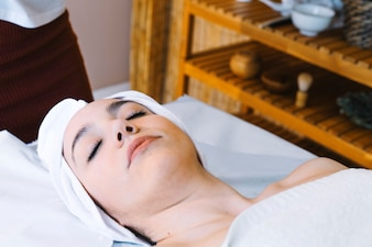 Spa and massage concept with relaxed woman