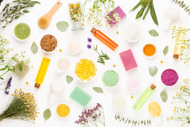 Spa aromatherapy floral background, flat lay of various beauty care products