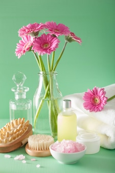 Spa aromatherapy with gerbera flowers essential oil brush