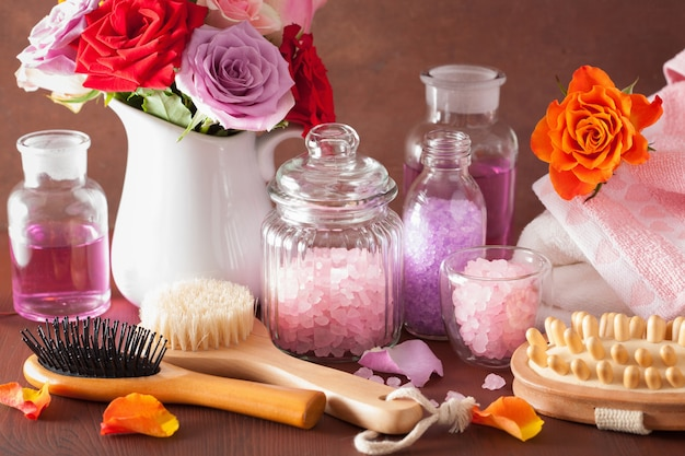 Spa aromatherapy with rose flowers essential oil salt brush
