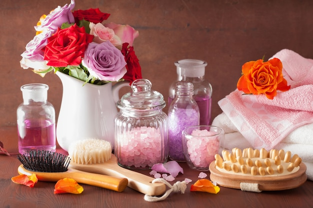 Spa aromatherapy with rose flowers, essential oils and salt brush
