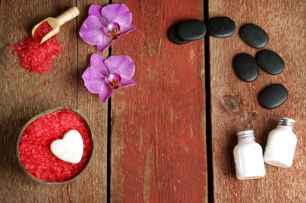 Spa background with orchid, red salt for coconut baths